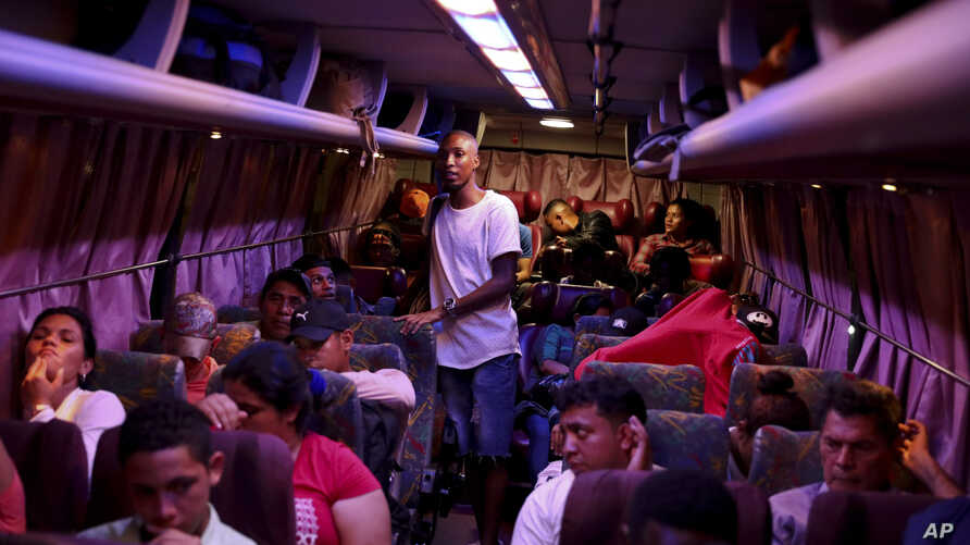 FILE - People wait on board a bus, on their way to the U.S. border, in Tegucigalpa, Honduras, Aug. 20, 2019.