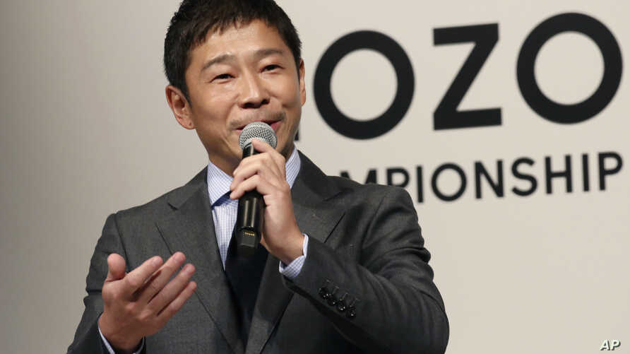 FILE - Zozo Chief Executive Yusaku Maezawa speaks during a press conference on the PGA Tour in Tokyo, Nov. 20, 2018.