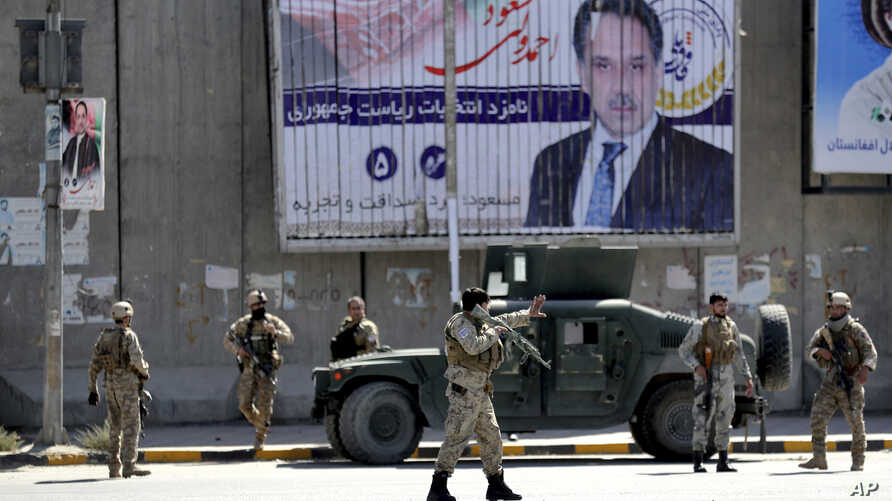 Afghan security forces work at the site of a suicide attack near the U.S. Embassy in Kabul, Afghanistan, Sept. 17, 2019.