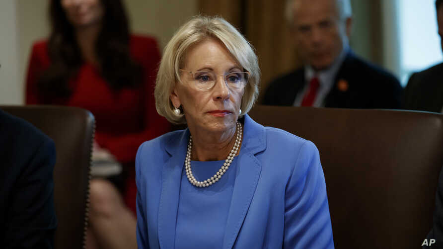 """FILE - Education Secretary Betsy DeVos is threatening to cut funding to a Middle East studies program at the University of North Carolina and Duke University, saying it advances """"ideological priorities"""" and unfairly promotes """"positive aspects of Islam."""""""