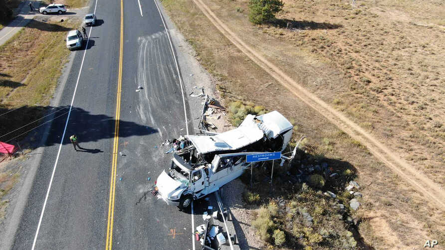 This photo provided by the Utah Highway Patrol shows a tour bus carrying Chinese-speaking tourists after it crashed near Bryce Canyon National Park in southern Utah, killing at least four people and critically injuring multiple others, Sept. 20, 2019.