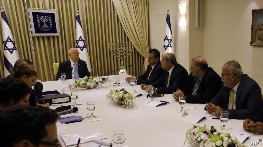 Israeli President Reuven Rivlin, cener left, speaks with members of the Joint List Ayman Odeh, fourth right, Ahmad Tibi, third right, Mansour Abbas, second right, and Osama Saadi, right, during a consultation meeting with in Jerusalem, Sept. 22, 2019.
