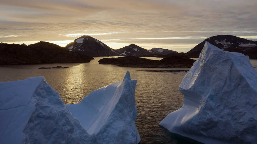Photo shows an aerial view of large Icebergs floating as the sun rises near Kulusuk, Greenland, Aug. 16, 2019.