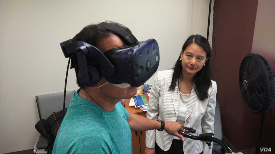 Keck School of Medicine of USC assistant professor Judy Pa watches as Wayne Garcia participates in a study that looks at whether
