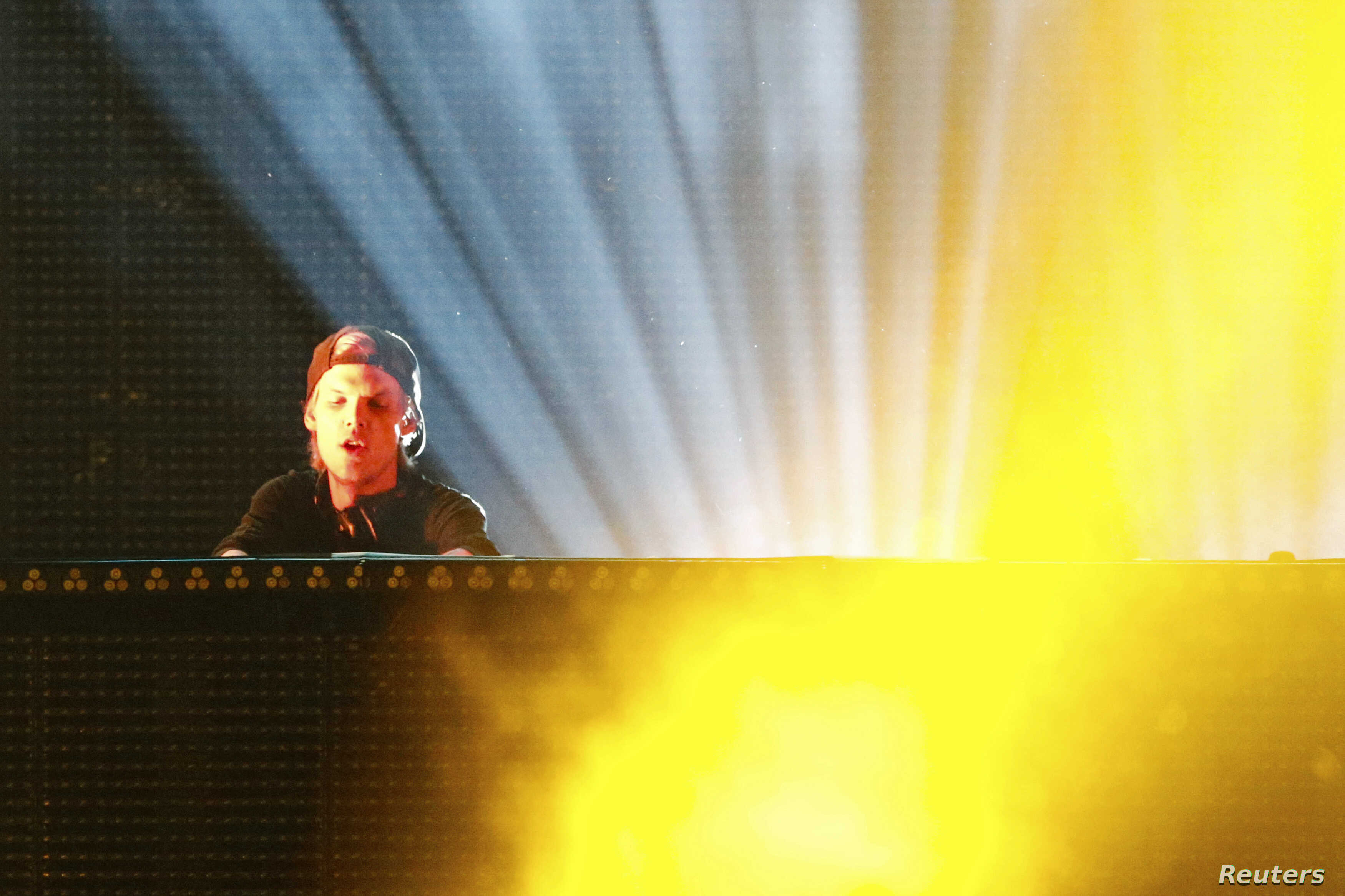 FILE - DJ Avicii performs during a concert at Brooklyn's Barclay's Center in New York, June 28, 2014.
