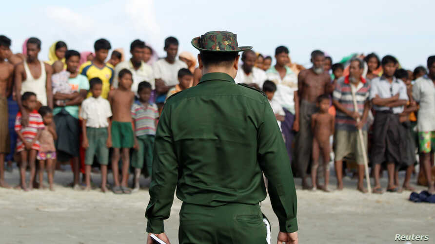FILE - Rohingya Muslims wait to cross the border to Bangladesh, in a temporary camp outside Maungdaw, northern Rakhine state, Myanmar, Nov. 12, 2017.