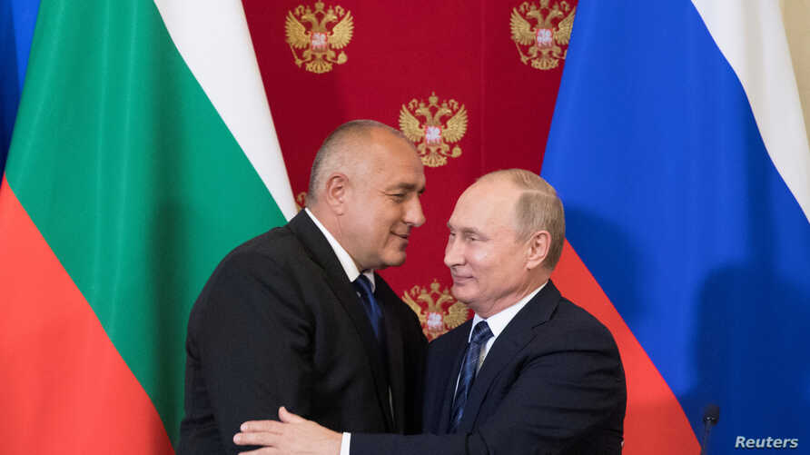 FILE - Russian President Vladimir Putin and Bulgarian Prime Minister Boyko Borissov hug after a joint news conference following their talks at the Kremlin in Moscow, Russia, May 30, 2018.