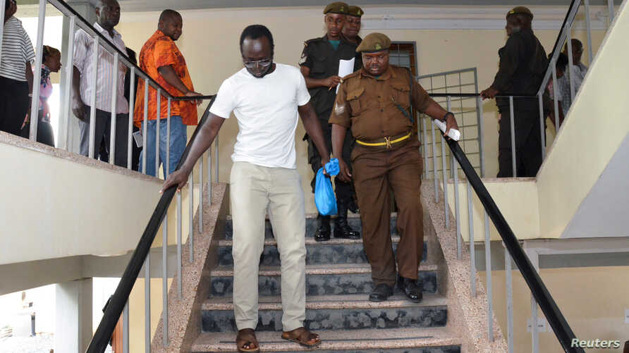 Tanzanian investigative journalist Erick Kabendera leaves after he appeared at the Kisutu residents magistrate court in Dar es Salaam, Tanzania, Sept. 12, 2019.