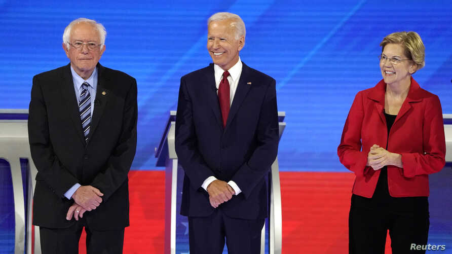 Senator Bernie Sanders joins former Vice President Joe Biden and Senator Elizabeth Warren onstage before the start at the 2020 Democratic U.S. presidential debate in Houston, Sept. 12, 2019.