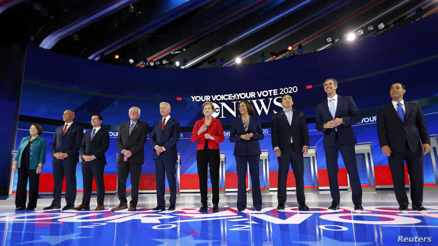 Democratic U.S. presidential candidates Senator Amy Klobuchar, Senator Cory Booker, South Bend Mayor Pete Buttigieg, Senator Bernie Sanders, former Vice President Joe Biden, Senator Elizabeth Warren, Senator Kamala Harris, entrepreneur Andrew Yang, former Rep. Beto O'Rourke and former Housing Secretary Julian Castro before the start at the 2020 Democratic U.S. presidential debate in Houston, Sept. 12, 2019.