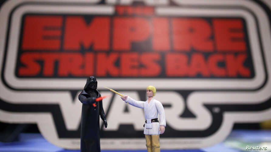 Vintage action figures of Star Wars characters Darth Vader (L) and Luke Skywalker stand on a table ahead of an auction of Star Wars and film related toys at the Vectis auction house in Stockton-on-Tees, Britain November 23, 2015.