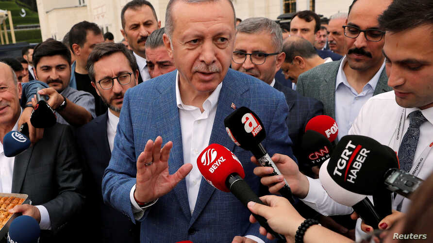 Turkish President Tayyip Erdogan talks to media after the Eid al-Fitr prayers to mark the end of the holy month of Ramadan in Istanbul, Turkey, June 4, 2019.