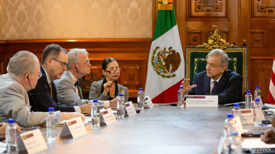 Mexico's President Andres Manuel Lopez Obrador holds a meeting with a delegation of U.S. lawmakers to talk about the United States-Mexico-Canada Agreement trade deal, at National Palace in Mexico City, Mexico July 19, 2019.