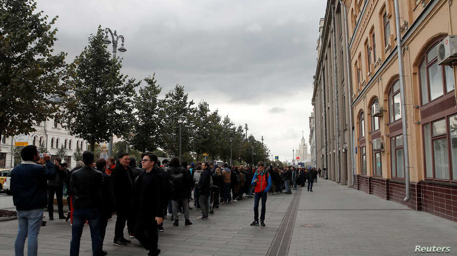 Participants attend a rally in front of the Presidential Administration building in Moscow, in support of Pavel Ustinov, who was sentenced to 3 1/2 years in prison for resisting police, Sept. 18, 2019.