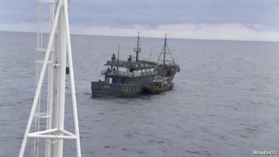 A video still released by Russia's Federal Security Service shows a North Korean boat during an incident in which Russian border guards detained two North Korean in the Sea of Japan on Sept. 17, 2019.