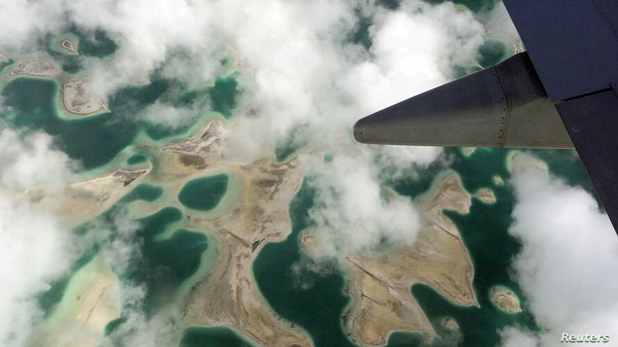 Lagoons can be seen from a plane as it flies above Kiritimati Island, part of the Pacific Island nation of Kiribati, April 5, 2016.