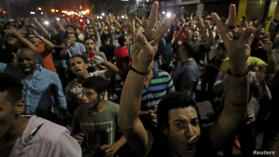 FILE - Protesters gather in central Cairo shouting anti-government slogans in Cairo, Egypt, Sept. 21, 2019.