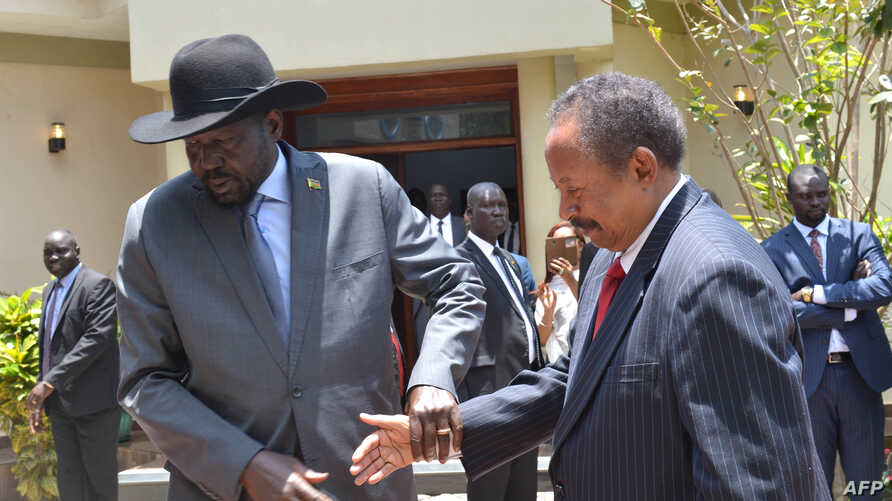 South Sudan's President Salva Kiir (L) and Sudan's Prime Minister Abdalla Hamdok shake hands before meeting in the capital city of Juba, South Sudan, Sept. 12, 2019.