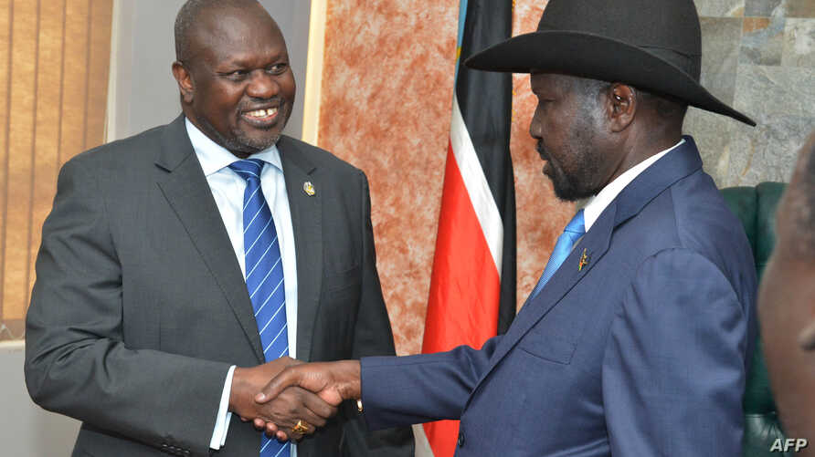 South Sudan's President Salva Kiir (R) shakes hands with opposition leader Riek Machar before their meeting in Juba, South Sudan, Sept. 11, 2019.
