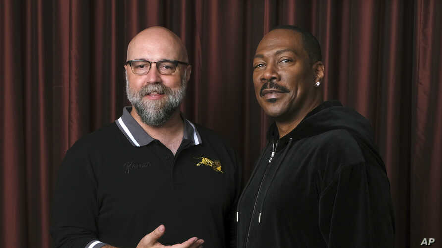"""Eddie Murphy, right, star of the film """"Dolemite Is My Name,"""" poses with director Craig Brewer at the Shangri-La Hotel during the Toronto International Film Festival in Toronto, Sept. 7, 2019."""