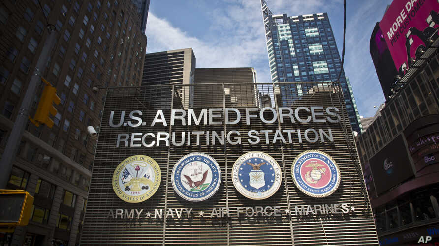 FILE - The Times Square military recruiting station displays insignia for each military branch in New York, July 15, 2015.