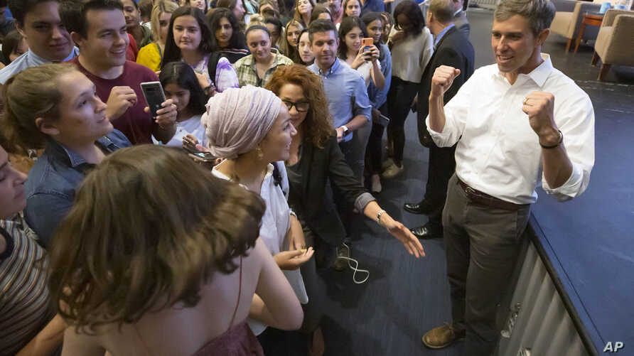 Democratic presidential candidate Beto O'Rourke greets students after speaking at a event at Tufts University in Medford, Massachusetts, Sept. 5, 2019.