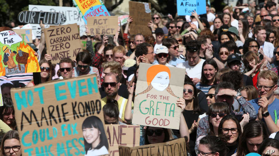 Activists march on Parliament to protest a lack of action on climate change, in Wellington, New Zealand, Sept. 27, 2019.