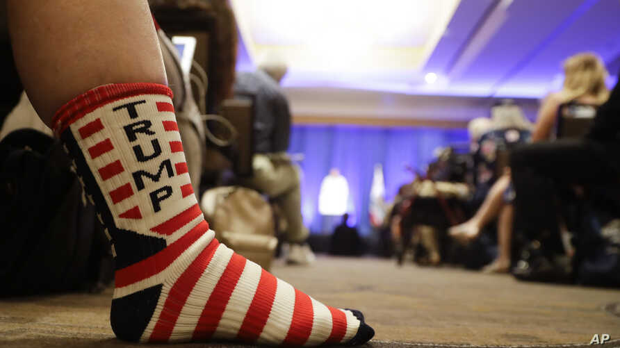 A supporter of President Donald Trump listens as Brad Parscale, campaign manager for Trump's 2020 reelection campaign, speaks during the California GOP fall convention in Indian Wells, Calif., Sept. 7, 2019.