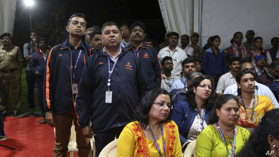 Indian Space Research Organization (ISRO) employees react as they listen to an announcement by organizations's chief Kailasavadivoo Sivan at its Telemetry, Tracking and Command Network facility in Bangalore, Sept. 7, 2019.