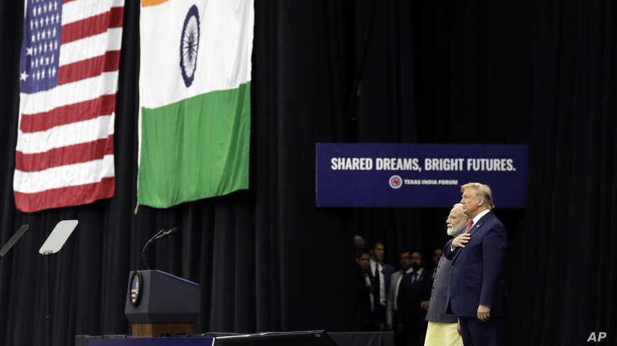 "President Donald Trump stands on stage with Indian Prime Minister Narendra Modi at NRG Stadium, Sept. 22, 2019, in Houston, during a ""Howdy Modi: Shared Dreams, Bright Futures"" event."