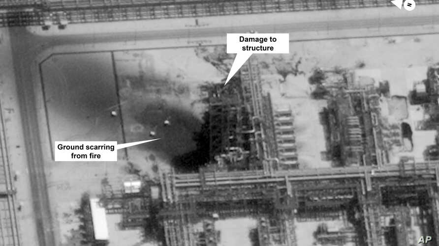 This image provided on Sept. 15, 2019, by the U.S. government and DigitalGlobe and annotated by the source, shows damage to the infrastructure at Saudi Aramco's Kuirais oil field in Buqyaq, Saudi Arabia.