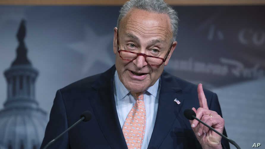 Senate Democratic Minority Leader Chuck Schumer talks to reporters at the Capitol in Washington, Aug. 1, 2019.
