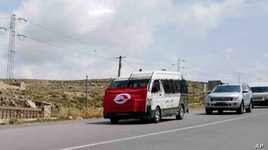 The convoy carrying the body of a slain Tunisian national guard head to his house in Kasserine, Sept. 2, 2019.
