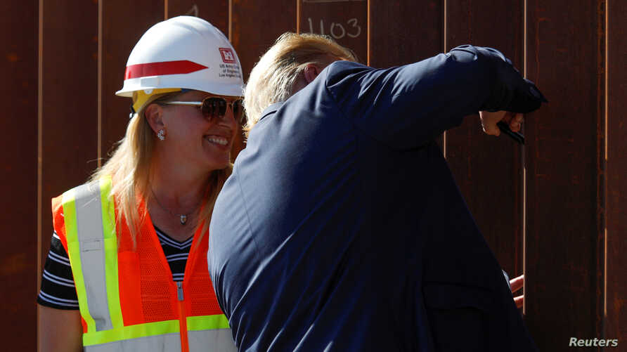 U.S. President Donald Trump signs his signature on the border wall while visiting a section of the U.S.-Mexico border wall in Otay Mesa, California, Sept. 18, 2019.
