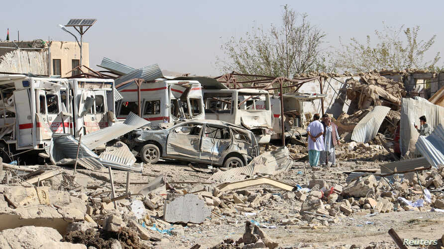 Damaged vehicles are seen at the site of a car bomb attack in Qalat, capital of Zabul province, Afghanistan, Sept. 19, 2019.