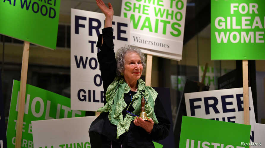 Author Margaret Atwood waves as she reads an extract during the launch of her new novel The Testaments at a book store in London, Britain, late Sept.  9, 2019.