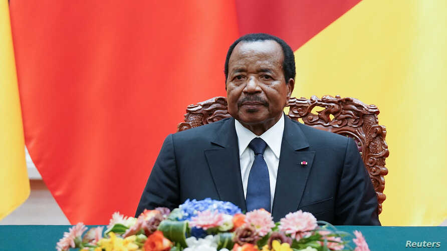 FILE - President of Cameroon Paul Biya with Chinese President Xi Jinping (not pictured) attend a signing ceremony at The Great Hall Of The People in Beijing, China, March 22, 2018.