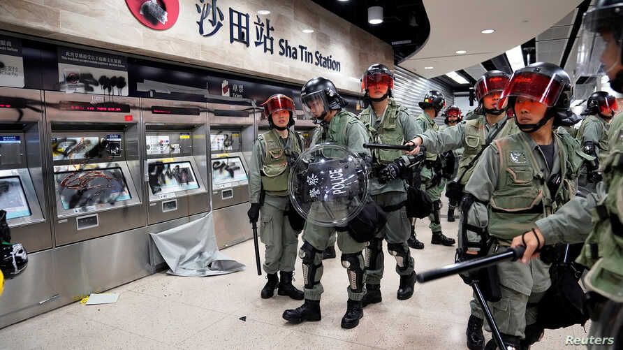 Police officers at Sha Tin Station in Hong Kong, Sept. 22, 2019.