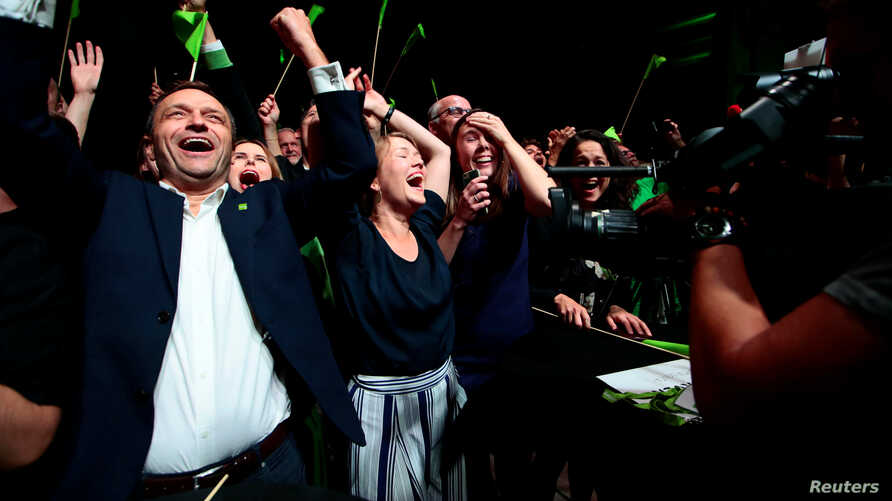 Leader of environmental MDG party Une Bastholm (right) and Arild Hermstad (left) cheer over the proviosional figures of local elections, in Oslo, Norway, Sept. 9, 2019.