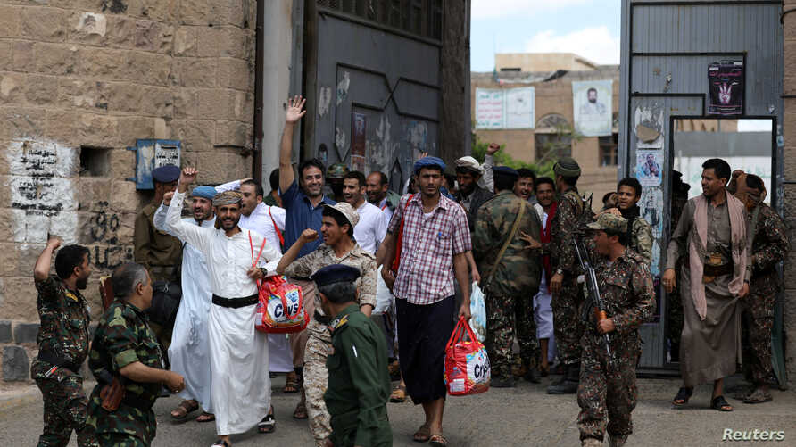 Detainees react as they leave the prison following their release by the Houthis in Sana'a, Yemen, Sept. 30, 2019.