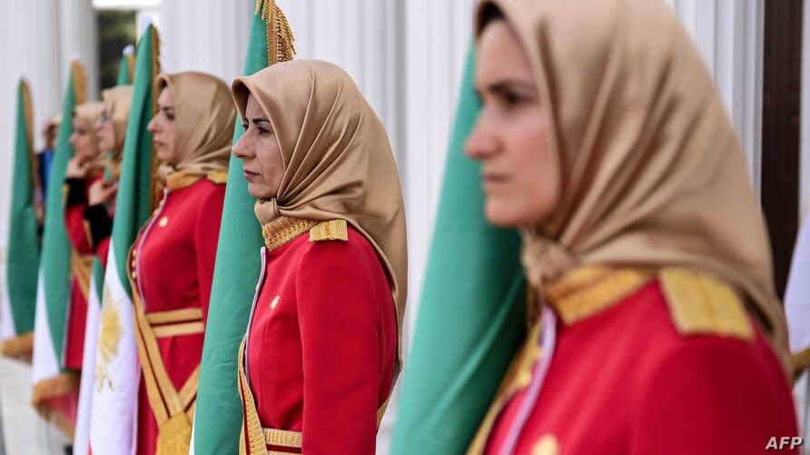"Mujahedin-e Khalq honor guard stand guard during a welcoming ceremony for personalities taking part in the conference ""120…"