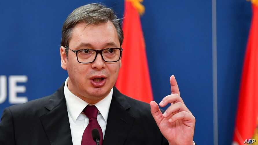 Serbian President Aleksandar Vucic gestures as he speaks during a joint press conference with Russian Prime Minister Dmitry…