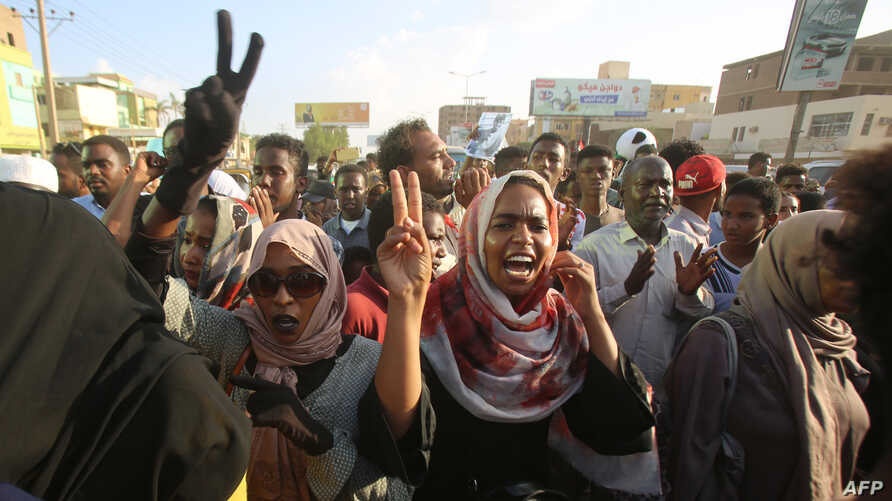 Sudanese demonstrators march during a protest in the capital Khartoum on October 21, 2019. - Thousands of Sudanese rallied in…