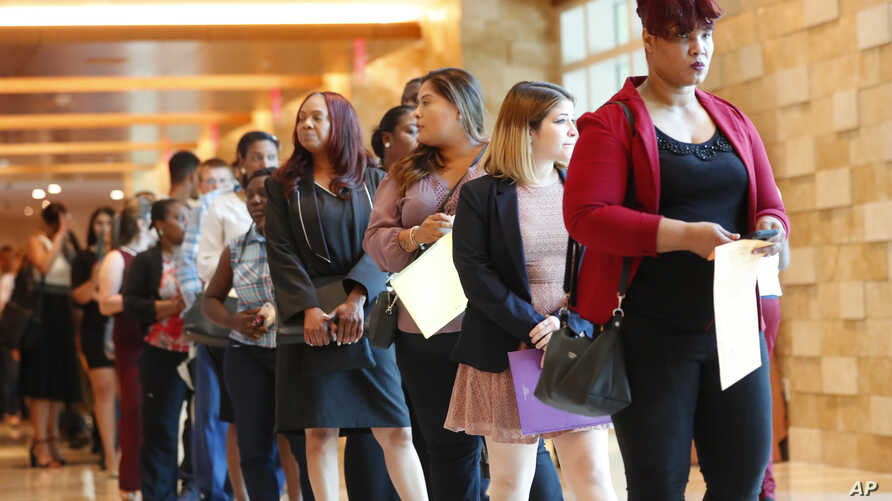 In this Tuesday, June 4, 2019 photo, job applicants line up at the Seminole Hard Rock Hotel & Casino Hollywood during a job…
