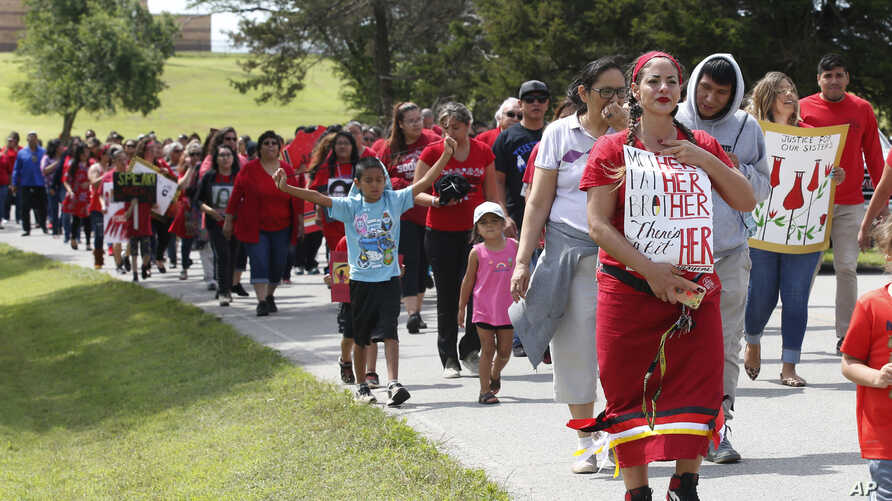 Photo shows a march to call for justice for missing and murdered indigenous women Friday