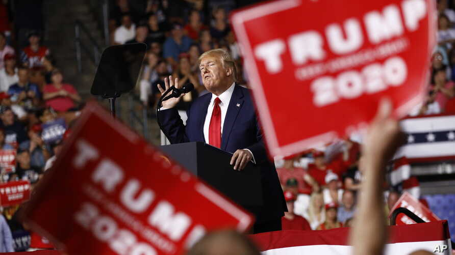 In this Aug. 15, 2019 photo, President Donald Trump speaks at a campaign rally in Manchester, N.H.