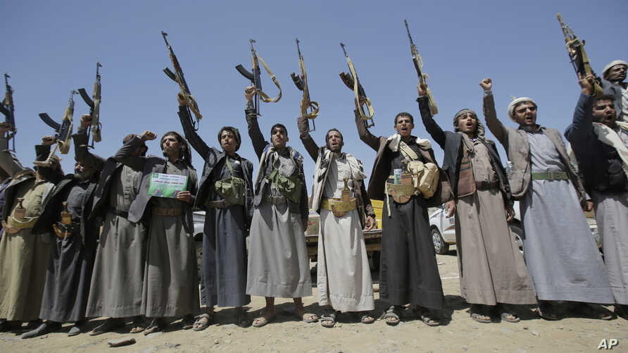 Shi'ite Houthi tribesmen hold their weapons as they chant slogans during a tribal gathering showing support for the Houthi movement, in Sanaa, Yemen, Sept. 21, 2019.