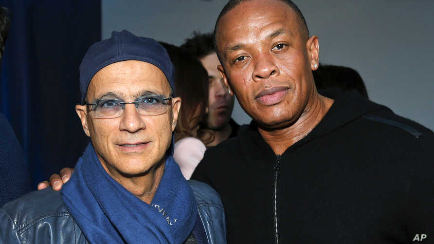 FILE - Music industry entrepreneur Jimmy Iovine, left, and hip-hop mogul Dr. Dre at a Grammy Party in Los Angeles, Feb. 10, 2013.