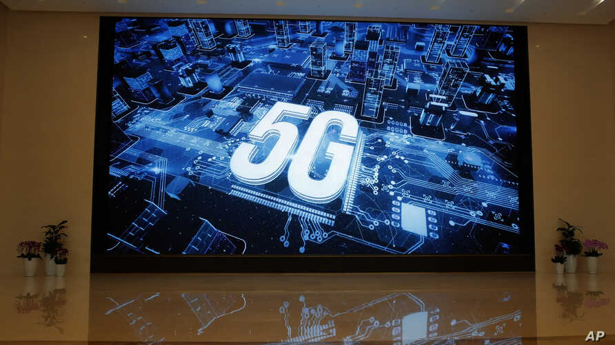 A 5G logo is displayed at the Huawei campus in Shenzhen city, China, March 6, 2019. Australia's ban on Huawei's involvement in its 5G networks and its crackdown on foreign covert interference are testing Beijing's efforts to project its power overseas.