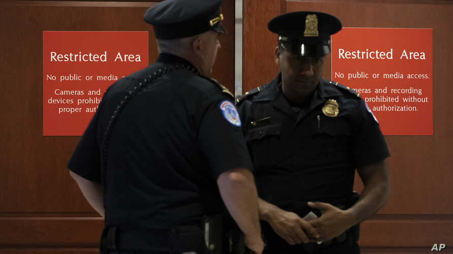 U.S. Capitol Police officers stand near a secure area during closed-door interviews as House Democrats proceed with the impeachment investigation of President at the Capitol in Washington, Oct. 3, 2019.